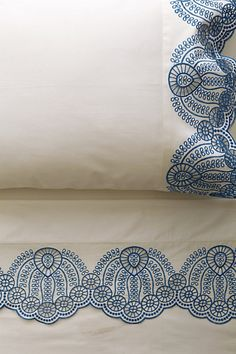 Eyelet Embroidered Sheet Set from Anthropologie.  Comes in blue, grey, white, yellow, coral, and mint.