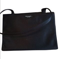 Kate Spade nylon bag Kate Spade classic Black nylon bag. Gently used. Some scuffs and wear but still looks great kate spade Bags Shoulder Bags