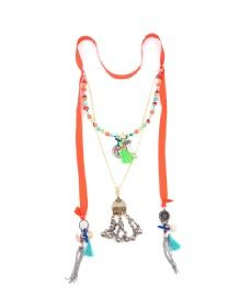 THAI TIE NECKLACE  Compliment a neutral wardrobe with this feminine double layer necklace. An Afghani pendant on a gold chain sits between a cluster of pendants on either side. The cluster consists of a blue cotton tassel, a silver beaded tassel, a bronze tusk, a gold coin and a small cut of tied leather. A row of pretty faceted and round beads are strung across the top layer with a metal tusk, a green cotton tassel and a small gold pendant in the centre. Double Layer Necklace, Gold Coins, Green Cotton, Silver Beads, Round Beads, Gold Pendant, Tassel, Centre, Neutral