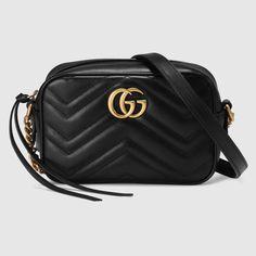 Shop the GG Marmont matelassé mini bag by Gucci. The mini GG Marmont chain shoulder bag has a softly Gucci Purses, Gucci Handbags, Leather Handbags, Gucci Bags, Designer Handbags, Mini Handbags, Gucci Gucci, Cheap Handbags, Designer Purses