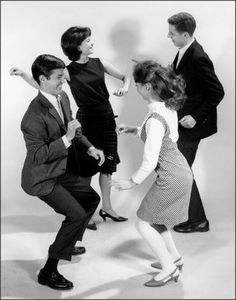 Teen couples dancing the twist, 1960's