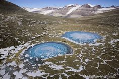 Twin frozen lakes in Bull Pass between Wright and Victoria Valley in Antarctica.