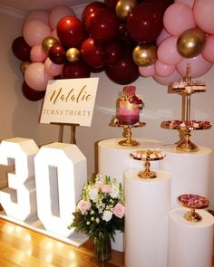 On display our light up numbers white round plinths and gold luxe cake stands and our acrylic board. Tap for additional vendors - 30th Birthday Celebration Ideas, 30th Birthday Party For Her, Thirty Birthday, Baptism Party Decorations, Balloon Decorations, Thirtieth Birthday, Goodbye Party, Acrylic Board, Baby Dedication