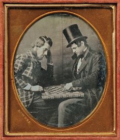 playing checkers ~ great example of men's civilian clothing.