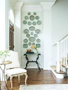 I always love a plate grouping. This one really draws your eye all the way up to the great high ceilings.