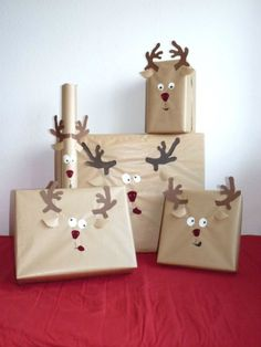 This super easy reindeer DIY will be a major hit with the kiddos. Simply use different colors of construction paper to replicate this goofy take on present wrapping. - WomansDay.com