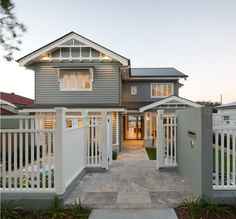Main house colour: Resene Stack Fence/trim/windows: Dulux Lexicon Quarter Roof/gutters: Dulux Woodland Grey