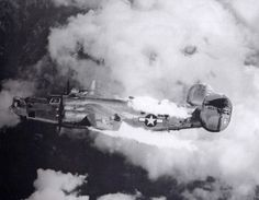 """The B-24 """"Extra Joker"""" bursts into flames after being attacked Fw-190s over Turnitz, Austria on August 23, 1944."""