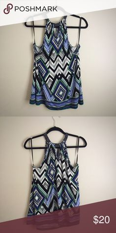 Sleeveless Geometric Top Flattering geometric pattern in black, royal blue, emerald green and white. Sleeveless with high, rounded neck. Keyhole accent at neckline. Perfect with a shrug or to wear alone. 95% Rayon, 5% Spandex. Machine wash. Size 14/16. Lane Bryant Tops Camisoles