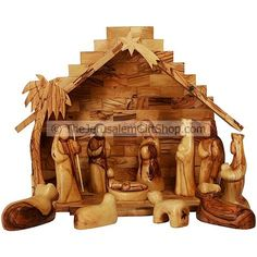 12 Piece large Nativity Set with faceless figures. Beautiful Christian gift from the Holy Land. The stable with has folding floors with Mary, Joseph, the three wise men and the animals are all hand made from Olive wood in Bethlehem. Size: 14 wide x 9 deep