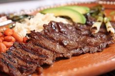 In Mexican cuisine, carne asada is a delicious dish made from thin marinated beef steak, usually skirt steak, flank steak or flap steak I Love Food, Good Food, Yummy Food, Beef Dishes, Tasty Dishes, Sauce Steak, Mexican Food Recipes, Dinner Recipes, Marinated Beef