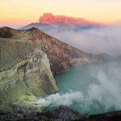 Mount Ijen smoking while Mount Raung erupts in the background at sunrise. East Java Indonesia. [OC] [640x640]   landscape Nature Photos