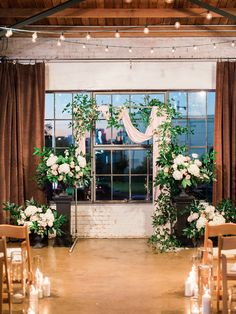 beautiful evening wedding ceremony with candle and bistro lights