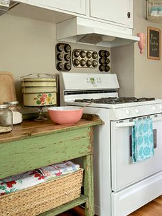 This simple kitchen has got charm for days with distressed side board, cupcake tins pinned to the wall and basket with linens ready for action. Lovely.