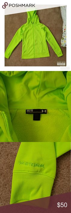 Like NEW UA Fleece Storm Zip Up Worn once & then washed delicates and tumble dry low. Price is firm as I paid a lot more! This zip up is neon, good for exercising as it gets dark, zips up all the way, has a FLEECE interior that keeps you cozy warm and storm technology repels water! What more could you want or need! Under Armour Sweaters