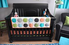 Teal/Turquoise, black crib, orange and green accents.