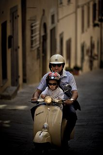 A father and his son on a Vespa scooter. They are so nice!