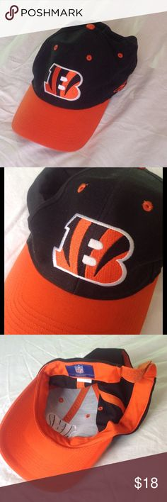Cincinnati Bengals NFL hat- hardly worn very clean Black, orange, and white... The Bengals!! Great NFL team hat that's hardly been used.  I used to collect apparel from various fields, and this was one thing I hardly (if ever) wore.  Reebok authentic NFL hat. Adjustable Velcro back - very clean as well. Reebok Accessories Hats