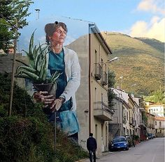 "A new piece by @fintan_magee in Sapri, Italy. ""Woman with Aloe Vera Plant."""