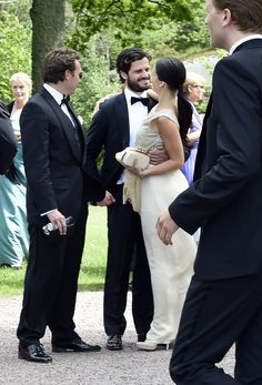 Prince Carl Philip with his fiancée Sofia Hellqvist at a wedding in May.