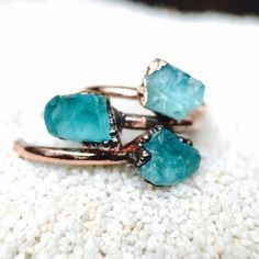 Looking for balance and some serene ocean blue? Check out these OOAK Blue Apatite raw gemstone rings. to bring a little reminder of balance and serenity to your daily grind. Click through to view more styles and read about the benefits of Apatite and Raw Copper Jewelry. #rawstonejewelry #rawstonering #crystalhealing