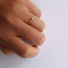 Teeny tiny engagement ring. Love it!