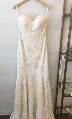 Lillian West 6425 wedding dress currently for sale at 47% off retail.