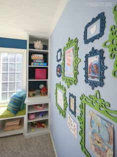 Paint inexpensive wooden (and glassless) frames from Michael's in bright colors to display kid's artwork. Great idea for a playroom art area. Displaying Kids Artwork, Artwork Display, Display Photos, Playroom Art, Playroom Ideas, Playroom Design, Playroom Paint Colors, Colorful Playroom, Toy Rooms