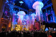 Giant jellyfish and tropical fish mobiles dangled overhead in the museum's rotunda, while blue lights gave the space a dreamy...