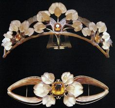 A tiara set with a citrine brooch by Lalique.  Lalique uses a curved horn base to showcase flowers cast in glass with fire-opal centres. The tiara resides in the Victoria and Albert Museum and was made, c. 1903/4.