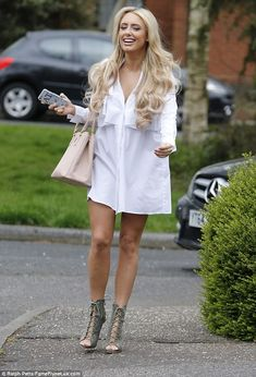 Amber Turner.. PrettyLittleThing Flora White Frill Front Shirt Dress, and Prada tote..