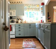 painted kitchen cabinets.  I have ugly pine cabinets and this has inspired me to paint my cupboards.  She did a really cute thing with her refridgerator as well if you read the whole thing.