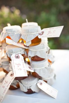 Use home made favors--like these mini honey jars or cute little individual pies--for your indoor rustic wedding. | Photography by joshgruetzmacher.com