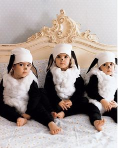 Little lamb costumes for Halloween -- I like the tiny black nose, and the white beanie with black ears