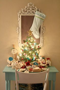 This is an advent tree but put little lighted trees in children's bedrooms for a festive seasonal nightlight. This was always my favorite tradition as a kid. I swear its impossible to have bad dreams when you're falling asleep to the light of a Christmas tree.