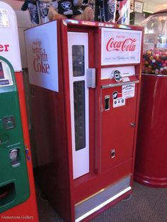 Coke machine. My grand parents had an OLD coke bottle machine just like this at their gas station when I was little. I think the cokes cost 50¢ in their machine. Of course I always got a free one. I liked pulling them out of the little door, but to get a free one my grandmother would open the back...which wasn't as much fun.