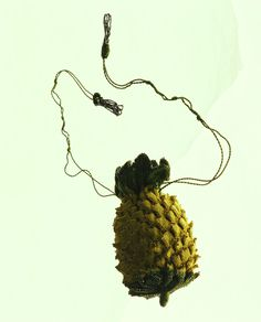 "Reticule, c. 1800, England, Yellow and green silk knit; pineapple shape with trimming of silver beads and tassels. 14cm / 9.5cm This small bag, called ""reticule"" at that time was elaborately and three-dimensionally knitted into the shape of a pineapple. Kyoto Costume Institute"