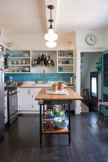 Pans hanging over the sink and super-sized subway tile  backsplash. My Houzz: Putting the Craft in an Ohio Craftsman