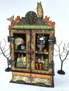 Stamptramp: Art with Heart Challenge - Hauntings and Holidays. Curio cabinet created with @graphic45 Rare Oddities and @eileen_hull  3D Cubes and Candy Drawer dies from @Sizzix. Made entirely from chipboard!