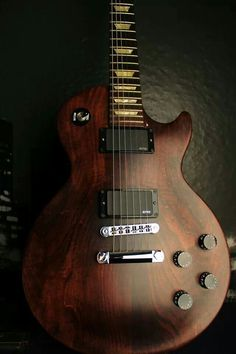 Late model Gibson Les Paul [faded finish] with added EMG active pickups.