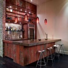 Barn boards added to bar. Notice the tractor seat stools!