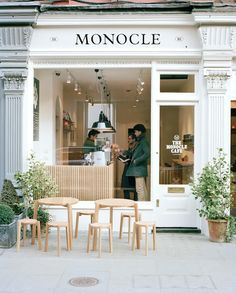 Monocle Cafe London. Use of black lettering on white pediment.