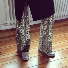 metallic pants and white converse