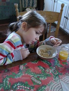 not wanting to eat oatmeal with my youngest oatmeal, via Flickr.