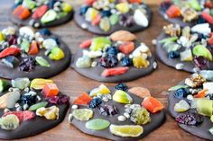 Dark Chocolate Super Food Medallions |  I used dried blueberries, cranberries, goji berries, figs, pineapple, mango, and papaya.  Walnuts, pistachios and almonds, hemp seeds and pepitas.  I collected them for color as well as flavor, and all of them have health giving properties, so these little dark chocolate medallions are not only guilt free, you'd be remiss not to include them in your diet!  @slmoran21