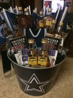 """Dallas Cowboys """"Man Bouquet"""" - Mini Liquor Bottles, Swisher Sweets, Big League Chew, Beer Bottle Coozy, Bottle Opener (connected to handle of pail), and Cowboys Flags around back to hide skewers. Very easy! Birthday Gift, Fathers Day, Valentine's Day, Anniversary..."""