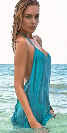 47c7af12acf4e L Space Drifter Peacock Tunic from South Beach Swimsuits is a green loose  fitting swimwear cover up with t back that falls to upper thigh.