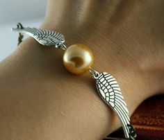 Golden Snitch Bracelet In Silver Steampunk Harry by BeautyandLuck, $2.99, I feel the need to purchase this