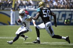 Danny Woodhead runs the ball during the first half of an NFL football game Sunday, Sept. 18, 2016, in San Diego. (AP Photo/Denis Poroy)