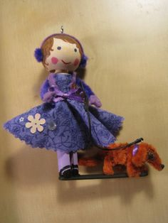 Dog walker clothespin doll ornament with her pipe-cleaner dachshund